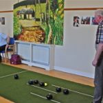 Photo of men playing indoor bowls at the Laurencetown Community Centre